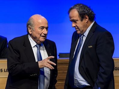 (FILES) In this file picture taken on June 11, 2014  FIFA president Joseph Blatter talks to UEFA president Michel Platini during the 64th FIFA congress in Sao Paulo, on the eve of the opening match of the 2014 FIFA World Cup in Brazil.    A FIFA ethics watchdog on October 8, 2015 suspended world body president Sepp Blatter and UEFA leader Michael Platini for 90 days after they were named in a Swiss corruption case.   AFP PHOTO / FABRICE COFFRINI