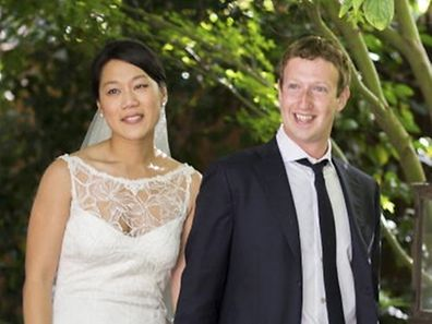Facebook co-founder and CEO Mark Zuckerberg and Priscilla Chan are seen in this wedding photo May 19, 2012. Zuckerberg wed longtime girlfriend Chan on Saturday, announcing the nuptials through a status update on the social networking site. REUTERS/Allyson Magda/Facebook.com/Handout (UNITED STATES - Tags: SOCIETY ENTERTAINMENT MEDIA PROFILE BUSINESS) NO SALES. NO ARCHIVES. FOR EDITORIAL USE ONLY. NOT FOR SALE FOR MARKETING OR ADVERTISING CAMPAIGNS