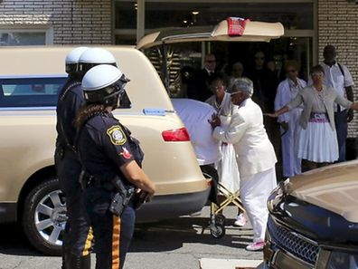 Workers of the Whigham Funeral Home push the coffin of Bobbi Kristina Houston into the hearse as they prepare to leave the funeral home for the cemetery in Newark, New Jersey August 3, 2015. Brown, the 22-year-old daughter of late singer Whitney Houston, died last week, months after she was found unresponsive in a bathtub.   REUTERS/Eduardo Munoz