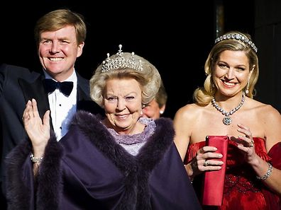Dutch Queen Beatrix, center, and Dutch Crown Prince Willem-Alexander, left, and his wife Princess Maxima arrive for a banquet hosted by the Dutch Royal family at the Rijksmuseum, Amsterdam, The Netherlands, Monday, April 29, 2013. Queen Beatrix has announced she will relinquish the crown on April 30, 2013, after 33 years of reign, leaving the monarchy to her son Crown Prince Willem-Alexander. (AP Photo/Robin Utrecht, pool)