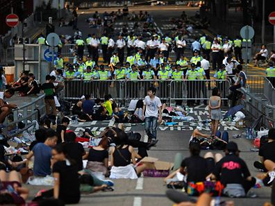 Protesters block a street near government headquarters in Hong Kong September 30, 2014