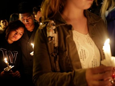 Students and community members attend a vigil at the Grove Church after a shooting at Marysville-Pilchuck High School in Marysville, Washington October 24, 2014