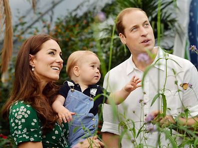 Taken in London on Wednesday July 2, 2014, to mark Britain's Prince George's first birthday, shows Prince William (R) and Catherine, Duchess of Cambridge (L) with Prince George during a visit to the Sensational Butterflies exhibition at the Natural History Museum in London.