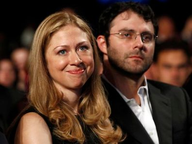 Chelsea Clinton, daughter of former U.S. President Bill Clinton, sits with her husband Marc Mezvinsky as U.S. President Barack Obama speaks at the Clinton Global Initiative in New York