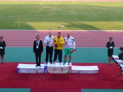 Bob Bertems, second from left, poses for a photo after winning silver for shot put at the 2015 Military World Games