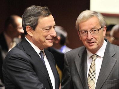 2011 file photo of European Central Bank president Mario Draghi with then Luxembourg Prime Minister and Eurogroup president Jean-Claude Juncker
