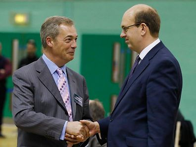 Nigel Farage (L), leader of the United Kingdom Independence Party (UKIP), shakes hands with Mark Reckless, the former Conservative Party member of Parliament for Rochester and Strood, during the by-election ballot