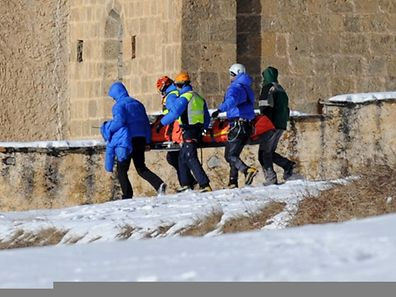 French rescuers carry on January 25, 2015 in church of Ceillac the body of one of six skiers victims of an avalanche a day earlier in the French Alps.