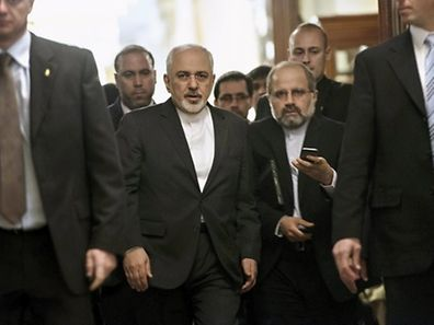 Iranian Foreign Minister Javad Zarif (C) leaves a meeting with U.S. Secretary of State John Kerry and other U.S. officials at the Beau Rivage Palace Hotel March 26, 2015 in Lausanne, Switzerland.  The United States and Iran resumed negotiations on Thursday aimed at clinching a nuclear deal before a March 31 deadline, and officials close to the talks said some kind of preliminary agreement between Tehran and six powers was possible. REUTERS/Brendan Smialowski/Pool