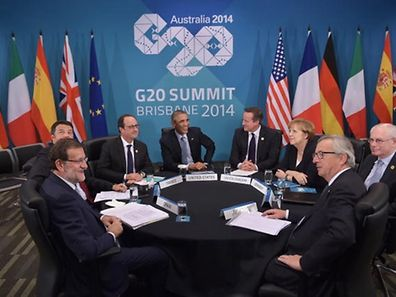 (from L-R) Spain's President Mariano Rajoy Brey, Italy's Prime Minister Matteo Renzi, France's President François Hollande, US President Barack Obama, Britain's Prime Minister David Cameron, Germany's Chancellor Angela Merkel and European Council President Herman Van Rompuy and European Commission President Jean-Claude Juncker take part in a multi-lateral meeting on the sidelines of the G20 Summit in Brisbane on November 16, 2014.
