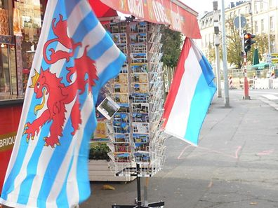 Luxembourg's maritime ensign, left, and its national flag, right