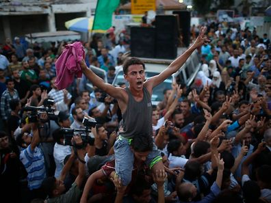 Palestinians celebrate what they said was a victory over Israel following a ceasefire in Gaza City August 26, 2014.