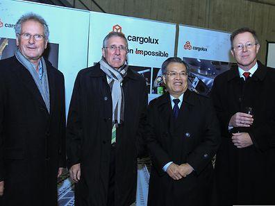 Paul Helminger, François Bausch, Zeng Xianqi et Dirk Reich manifestant leur union dans un élan commercial vers la Chine.