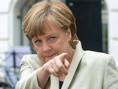 German Chancellor Angela Merkel gestures during her visit to the Roentgen school in Berlin, Germany, in this file photo taken May 12, 2015.  Merkel was named the 'World's Most Powerful Woman in 2015' in Forbes Magazine annual ranking released on Tuesday.   REUTERS/Maurizio Gambarini/Pool/Files