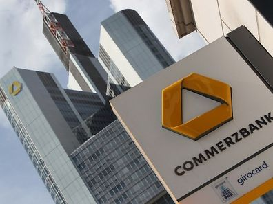 FILES - Picture taken on April 28, 2015, shows the logo of German bank Commerzbank in front of the company's headquarters in Frankfurt am Main, western Germany. Germany's second biggest banking group Commerzbank said on August 3, 2015,  its second quarter profits had almost tripled, pushed up by higher revenue and a lower tax bill.  AFP PHOTO / DANIEL ROLAND