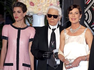 Princess Caroline of Hanover (R) poses with German designer Karl Lagerfeld (C) and her daughter Charlotte (L) as they arrive at the Bal de la Rose in Monte Carlo March 28, 2015. The Bal de la Rose is a traditional annual charity event in aid of Foundation Princess Grace. REUTERS/Eric Gaillard