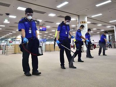 (FILES) In a file photo taken on June 17, 2015, South Korean workers spray antiseptic solution at the customs, immigration and quarantine office (CIQ) of Gimpo international airport in Seoul