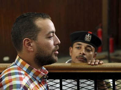 Al Jazeera television journalist Baher Mohamed talks to journalists before hearing the verdict at a court in Cairo, Egypt