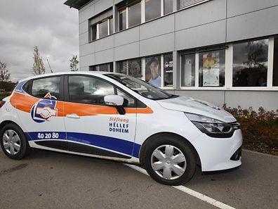 Die bunten Autos des Pflegedienstes gehören zum Straßenbild in Luxemburg.