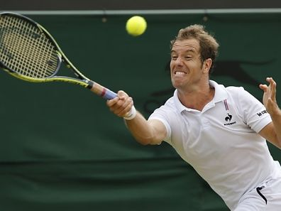 France's Richard Gasquet returns against Australia's Nick Kyrgios during their men's singles fourth round match on day seven of the 2015 Wimbledon Championships at The All England Tennis Club in Wimbledon, southwest London, on July 6, 2015.   RESTRICTED TO EDITORIAL USE  --   AFP PHOTO / ADRIAN DENNIS