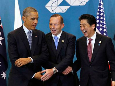 U.S. President Barack Obama, Australian Prime Minister Tony Abbott and Japanese Prime Minister Shinzo Abe meet at the G20 in Brisbane