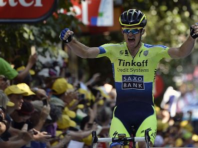 Australia's Michael Rogers celebrates as he crosses the finish line at the end of the 237.5 km sixteenth stage of the 101st edition of the Tour de France cycling race on July 22, 2014