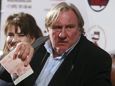 Actors Gerard Depardieu (R) and Fanny Ardant attend a news conference