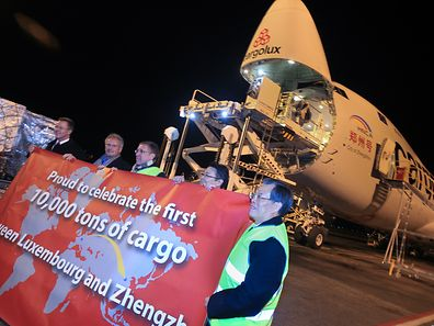 10,000 tonnes of cargo shifted between Luxembourg and Zhengzhou. The landmark is celebrated at Luxembourg by Cargolux CEO Dirk Reich, Paul Helminger, Sustainable Development Minister François Bausch, Richard Forson and the Chinese Ambassador to Luxembourg Zeng Xianqi.