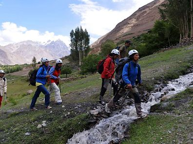 Pakistani students from the Shimshal Mountaineering School prepare to climb near the Shimshal village in the northern Hunza valley, Pakistan