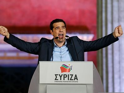 """The head of radical leftist Syriza party Alexis Tsipras speaks to supporters after winning the elections in Athens January 25, 2015. Tsipras promised on Sunday that five years of austerity, """"humiliation and suffering"""" imposed by international creditors were over after his Syriza party swept to victory in a snap election on Sunday"""