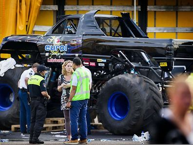 Dutch policemen inspect the site of an accident after a monster truck drove accidentally into the audience during a demonstration in Haaksbergen, killing three people and injuring dozens, on September 28, 2014. AFP PHOTO/ANP/ VINCENT JANNINK 
