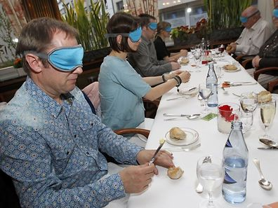 "During a ""dinner in the dark"" people will have to concentrate on the rest of their senses"
