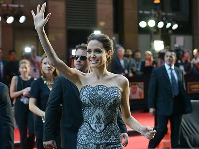 "US actress and director Angelina Jolie waving to fans as she arrives for the world premiere of her new movie 'Unbroken' in Sydney. Jolie said on November 20 she plans to give up acting after a ""few more"" films and switch her focus to directing"