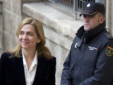 (FILES) A file picture taken on February 8, 2014 shows Spanish Infanta Cristina (L) smiling as she arrives at the courthouse of Palma de Mallorca, on the Spanish Balearic Island of Mallorca. A judge on December 22, 2014 ordered the sister of Spain's King Felipe VI, Cristina, to stand trial for alleged tax fraud, a court source said, the first time a member of the Spanish royal family has been sent to the dock. AFP PHOTO / JAIME REINA