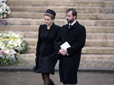 Prince Guillaume (R), hereditary Grand-Duke of Luxembourg and Belgian Countess Stephanie de Lannoy take part in a funeral procession from the Saint Michael and St Gudula Cathedral to the Notre-Dame church during the funeral ceremony for Belgian Queen Fabiola in Brussels