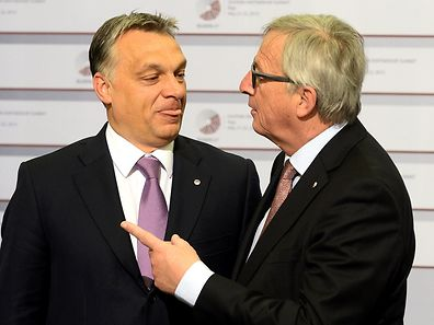 Hungarian Prime Minister Viktor Orban is greeted by President of the European Commission Jean-Claude Juncker on May 22, 2015