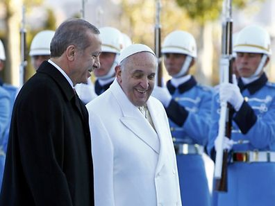 Pope Francis and Turkey's President Tayyip Erdogan walk in front of honor guard at the presidential palace in Ankara November 28, 2014