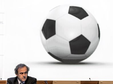 (FILES) A picture taken on June 11, 2014 shows UEFA president Michel Platini attending the 64th FIFA congress in Sao Paulo on the eve of the opening match of the 2014 FIFA World Cup in Brazil. Platini is to stand as a candidate for the presidency of world football's governing body FIFA, UEFA announced on July 29, 2015. AFP PHOTO / FABRICE COFFRINI