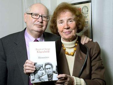 "Serge Klarsfeld and his wife Beate Klarsfeld pose with their book ""Memoires"" (Memories) in Paris on March 30"
