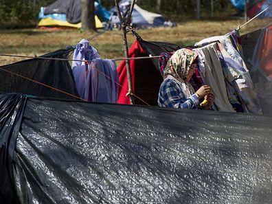 A refugee girl is seen near makeshift tents outside of Austria's main refugee camp in Traiskirchen