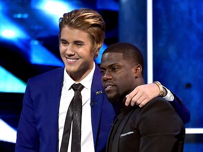 LOS ANGELES, CA - MARCH 14: Honoree Justin Bieber (L) and comedian Kevin Hart onstage at The Comedy Central Roast of Justin Bieber at Sony Pictures Studios on March 14, 2015 in Los Angeles, California. The Comedy Central Roast of Justin Bieber will air on March 30, 2015 at 10:00 p.m. ET/PT.   Kevin Winter/Getty Images/AFP == FOR NEWSPAPERS, INTERNET, TELCOS & TELEVISION USE ONLY ==