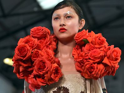 A model parades an outfit by Australian designer Akira Isogawa during Fashion Week Australia in Sydney on April 15, 2015.  AFP PHOTO / William WEST