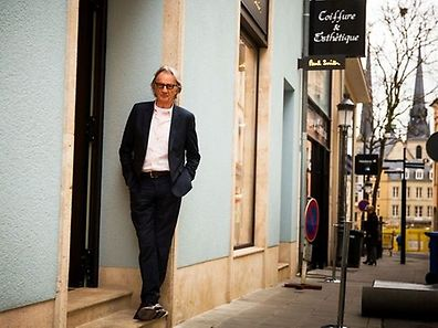 Paul Smith poses outside of his new store in rue du Fossé in Luxembourg City