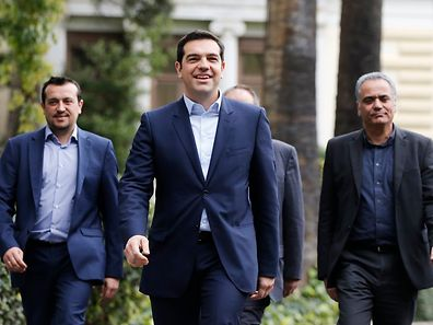 Greece's newly-appointed Prime Minister Alexis Tsipras (C) leaves the Presidential Mansion after his swearing-in ceremony as Greece's first leftist prime minister in Athens January 26, 2015.
