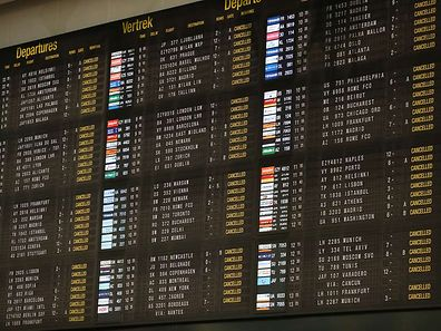 A photo taken on December 14, 2014 at Zaventem airport shows the departures board showing the cancelled flights  at the start of a 24-hour general strike in Belgium