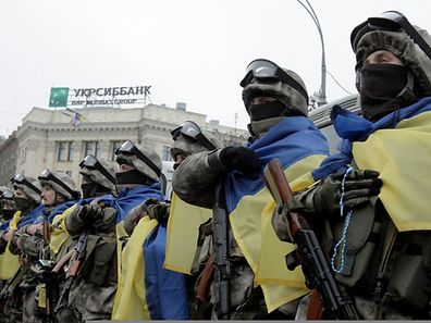 Members of a special unit of the Ukrainian armed forces line up during a farewell ceremony before departing to take part in a military operation
