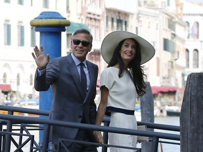 US actor George Clooney and British lawyer Amal Alamuddin arrive on September 29, 2014 at the palazzo Ca Farsetti in Venice,