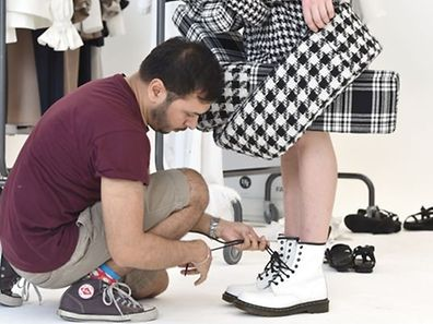 "Pakistani designer Syed Shahid Nisar controls one of his creations during the fitting for the show ""Designer for Tomorrow"" (DfT) in the run-up to the Mercedes-Benz Fashion Week in Berlin on July 5, 2015. According to organisers, the �Designer for Tomorrow� award (DfT) is ""a visible platform for creative ability and offers top up-and-coming designers a chance to be discovered as such and to gain the attention of the fashion industry and the general public"". The Mercedes-Benz Fashion Week will be running from July 7 to 10, 2015.     AFP PHOTO / DPA / JENS KALAENE   +++   GERMANY OUT"