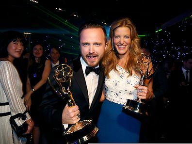 "AMC's ""Breaking Bad"" star Aaron Paul with his Outstanding Supporting Actor in a Drama Series award and Anna Gunn with her Outstanding Supporting Actress in a Drama Series award"