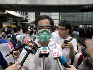 Pro-democracy activist and former legislator Martin Lee, wearing goggles and a mask to protect against pepper spray
